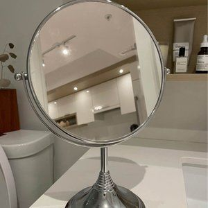 Double sided mirror- magnified on one side